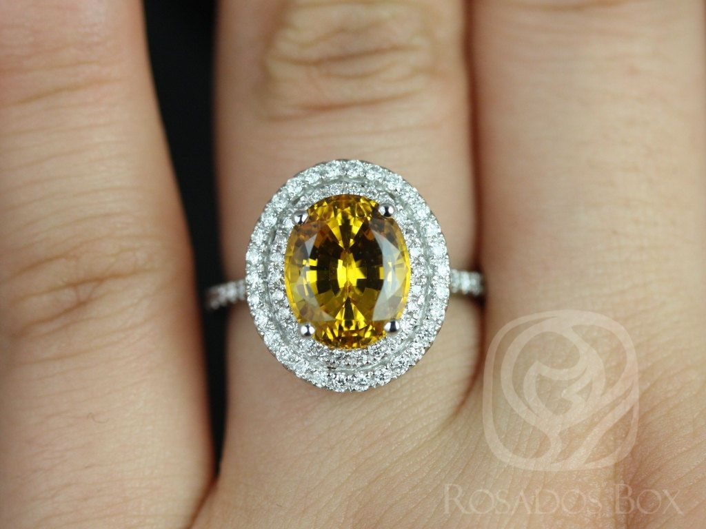 https://www.loveandpromisejewelers.com/media/catalog/product/cache/1b8ff75e92e9e3eb7d814fc024f6d8df/c/a/cara_10x8mm_14kt_white_gold_oval_yellow_sapphire_and_diamonds_double_halo_engagement_ring_4_wm.jpg