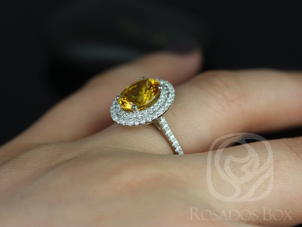 https://www.loveandpromisejewelers.com/media/catalog/product/cache/1b8ff75e92e9e3eb7d814fc024f6d8df/c/a/cara_10x8mm_14kt_white_gold_oval_yellow_sapphire_and_diamonds_double_halo_engagement_ring_5_wm.jpg