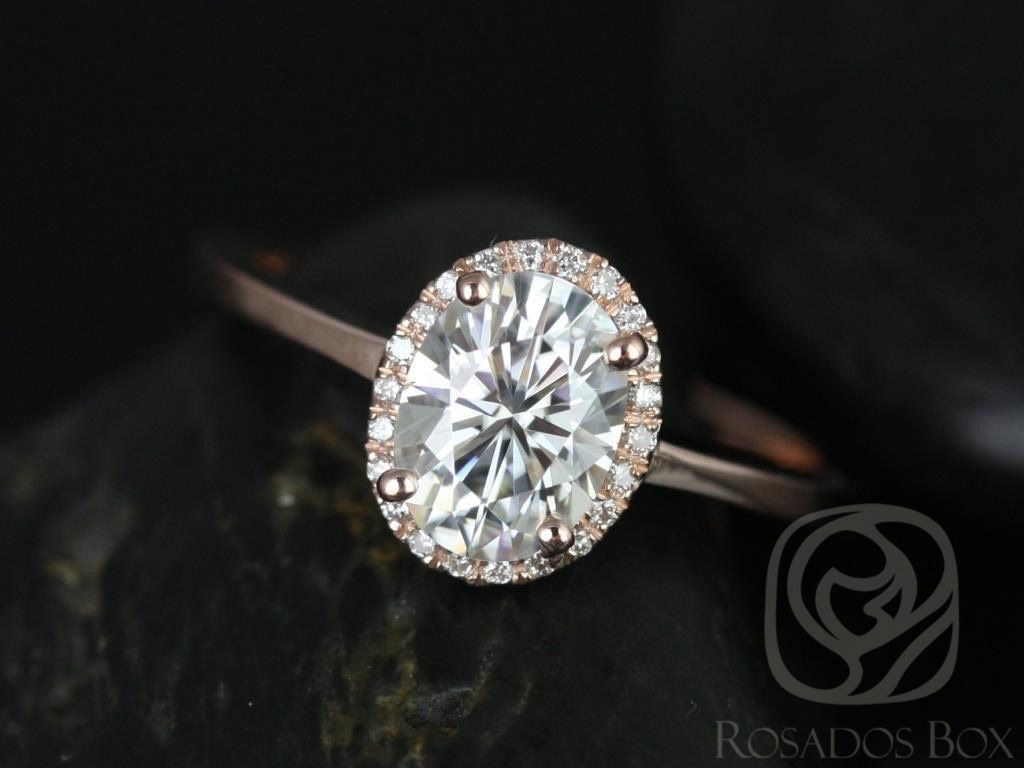 https://www.loveandpromisejewelers.com/media/catalog/product/cache/1b8ff75e92e9e3eb7d814fc024f6d8df/c/e/celeste_8x6mm_14kt_rose_gold_oval_fb_moissanite_and_diamonds_pave_halo_engagement_ring_other_metals_and_stone_options_available_1wm.jpg