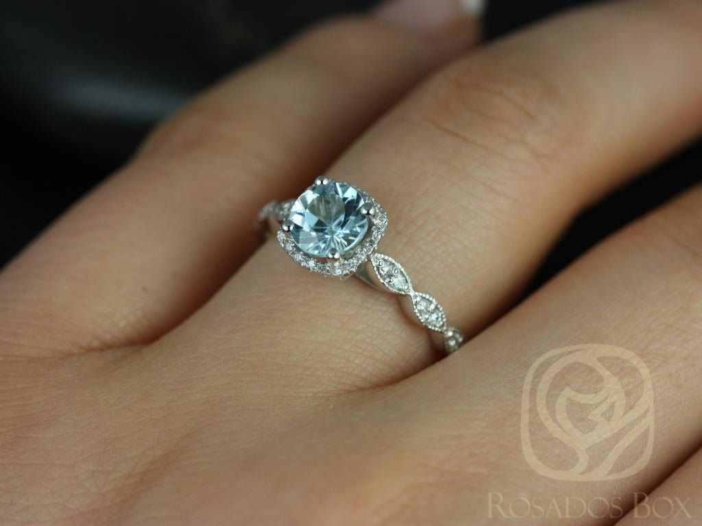 https://www.loveandpromisejewelers.com/media/catalog/product/cache/1b8ff75e92e9e3eb7d814fc024f6d8df/c/h/christie_6mm_14kt_white_gold_aquamarine_and_diamonds_cushion_halo_with_milgrain_engagement_ring_other_metals_and_stone_options_available_5wm.jpg