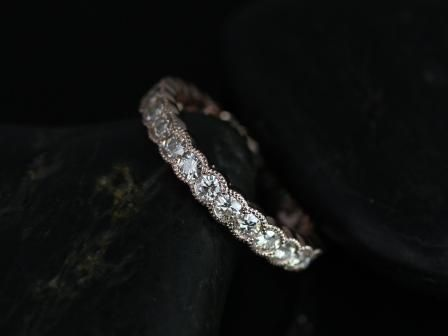 https://www.loveandpromisejewelers.com/media/catalog/product/cache/1b8ff75e92e9e3eb7d814fc024f6d8df/c/o/cordelia_moissanite_with_single_row_milgrain_rose_gold_eternity_ring_4_.jpg