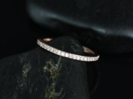 https://www.loveandpromisejewelers.com/media/catalog/product/cache/1b8ff75e92e9e3eb7d814fc024f6d8df/d/i/diana_diamond_rose_gold_wedding_ring_3_.jpg