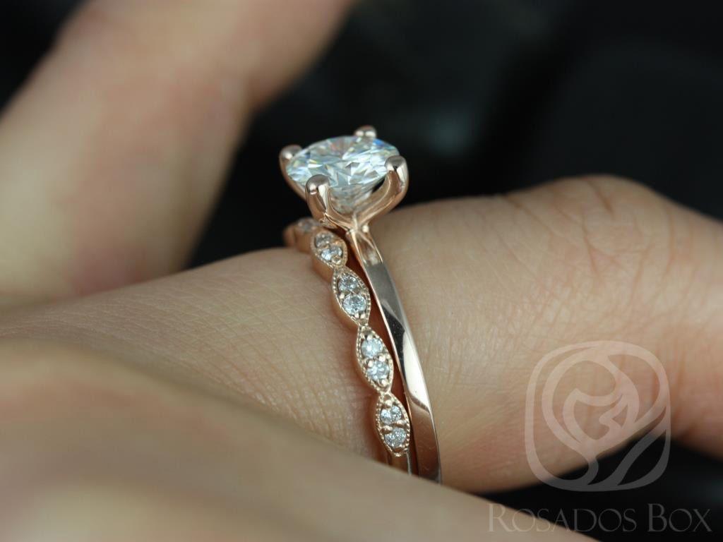 https://www.loveandpromisejewelers.com/media/catalog/product/cache/1b8ff75e92e9e3eb7d814fc024f6d8df/e/l/ella_7mm_christie_14kt_rose_gold_round_fb_moissanite_and_diamonds_wedding_set_1wm_.jpg