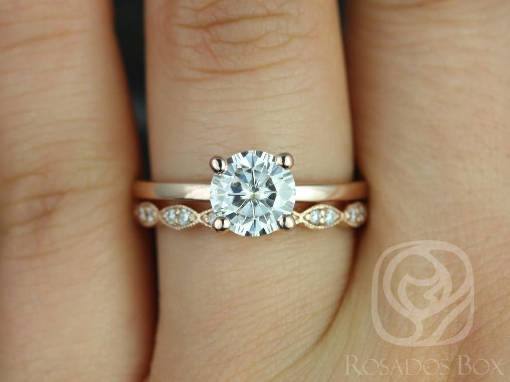 https://www.loveandpromisejewelers.com/media/catalog/product/cache/1b8ff75e92e9e3eb7d814fc024f6d8df/e/l/ella_7mm_christie_14kt_rose_gold_round_fb_moissanite_and_diamonds_wedding_set_2wm_.jpg