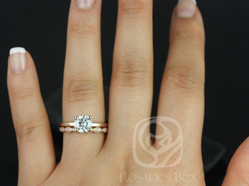 https://www.loveandpromisejewelers.com/media/catalog/product/cache/1b8ff75e92e9e3eb7d814fc024f6d8df/e/l/ella_7mm_christie_14kt_rose_gold_round_fb_moissanite_and_diamonds_wedding_set_3wm_.jpg