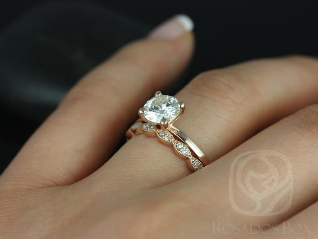 https://www.loveandpromisejewelers.com/media/catalog/product/cache/1b8ff75e92e9e3eb7d814fc024f6d8df/e/l/ella_7mm_christie_14kt_rose_gold_round_fb_moissanite_and_diamonds_wedding_set_4wm_.jpg