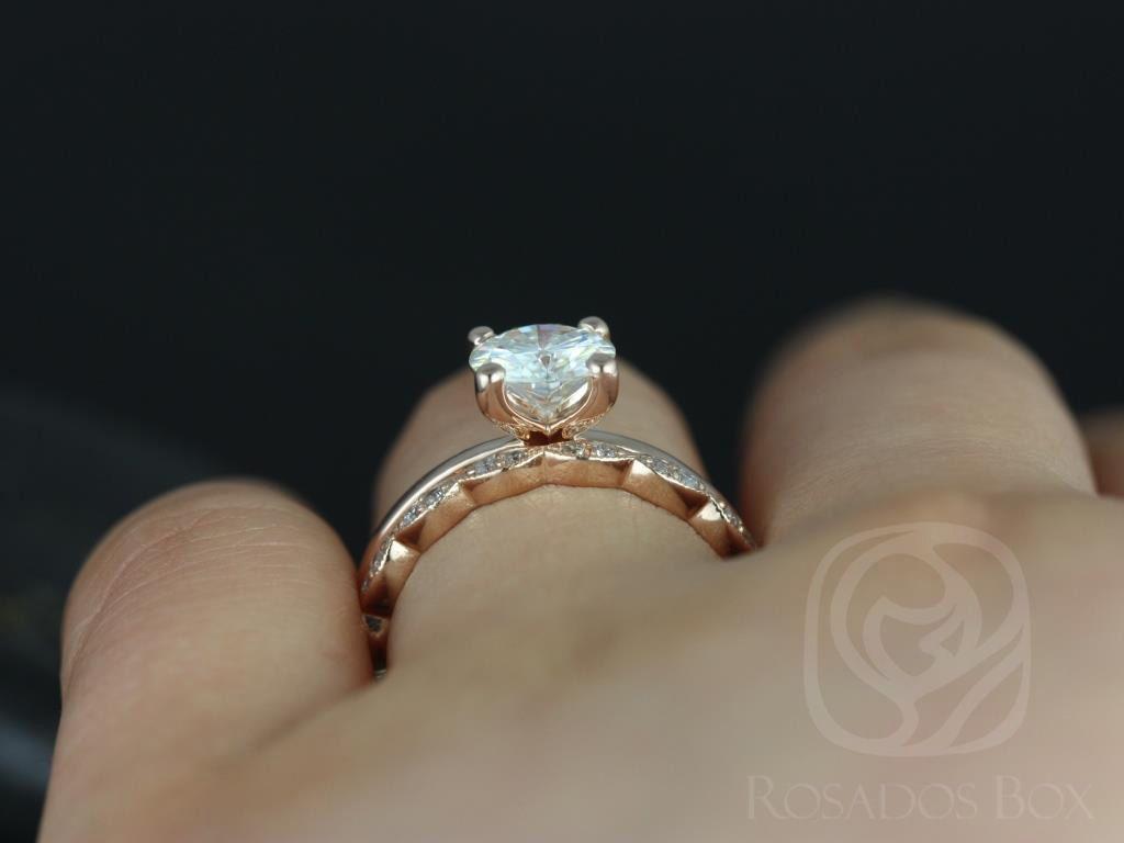 https://www.loveandpromisejewelers.com/media/catalog/product/cache/1b8ff75e92e9e3eb7d814fc024f6d8df/e/l/ella_7mm_christie_14kt_rose_gold_round_fb_moissanite_and_diamonds_wedding_set_5wm_.jpg