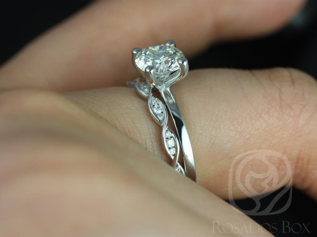 https://www.loveandpromisejewelers.com/media/catalog/product/cache/1b8ff75e92e9e3eb7d814fc024f6d8df/e/l/ella_7mm_ember_14kt_white_gold_round_fb_moissanite_and_diamonds_wedding_set_1wm_.jpg