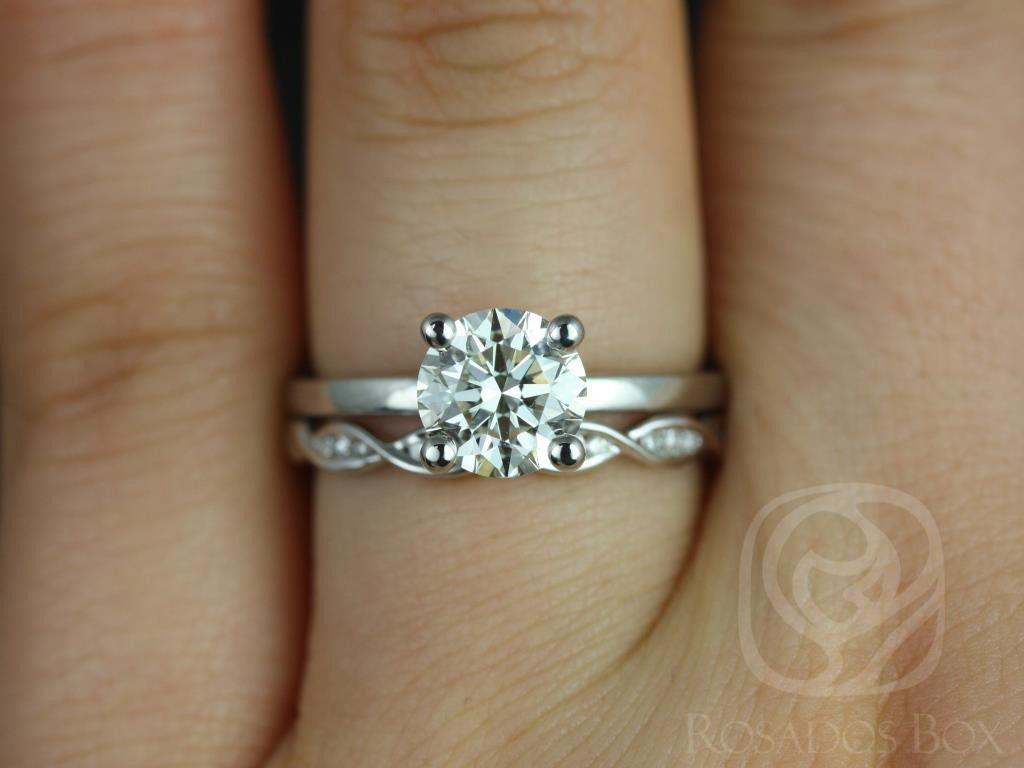 https://www.loveandpromisejewelers.com/media/catalog/product/cache/1b8ff75e92e9e3eb7d814fc024f6d8df/e/l/ella_7mm_ember_14kt_white_gold_round_fb_moissanite_and_diamonds_wedding_set_2wm_.jpg