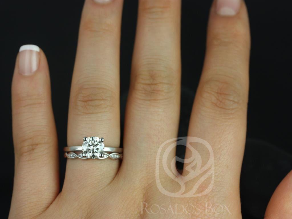 https://www.loveandpromisejewelers.com/media/catalog/product/cache/1b8ff75e92e9e3eb7d814fc024f6d8df/e/l/ella_7mm_ember_14kt_white_gold_round_fb_moissanite_and_diamonds_wedding_set_3wm_.jpg