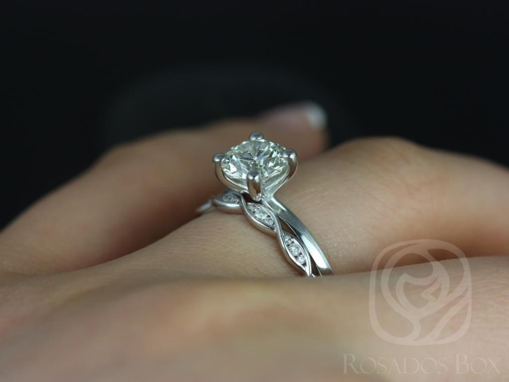 https://www.loveandpromisejewelers.com/media/catalog/product/cache/1b8ff75e92e9e3eb7d814fc024f6d8df/e/l/ella_7mm_ember_14kt_white_gold_round_fb_moissanite_and_diamonds_wedding_set_4wm_.jpg