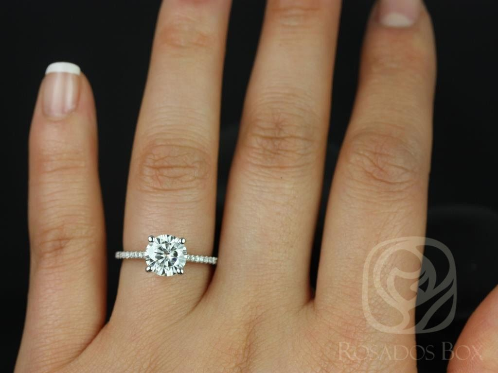 https://www.loveandpromisejewelers.com/media/catalog/product/cache/1b8ff75e92e9e3eb7d814fc024f6d8df/e/l/eloise_7.5mm_size_14kt_white_gold_round_fb_moissanite_and_diamonds_cathedral_engagement_ring_4wm.jpg