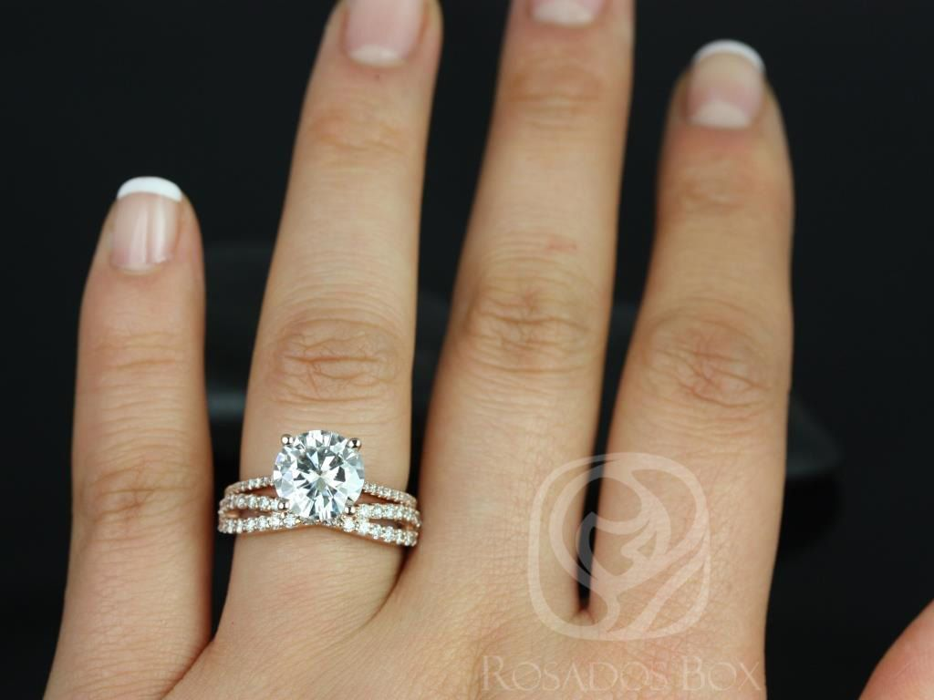 https://www.loveandpromisejewelers.com/media/catalog/product/cache/1b8ff75e92e9e3eb7d814fc024f6d8df/e/l/eloise_9mm_lima_14kt_rose_gold_round_fb_moissanite_and_diamonds_cathedral_wedding_set_6wm_.jpg