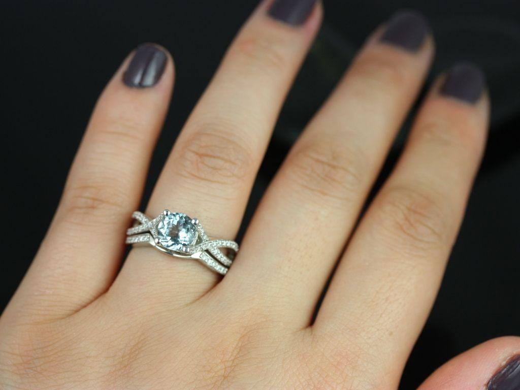 https://www.loveandpromisejewelers.com/media/catalog/product/cache/1b8ff75e92e9e3eb7d814fc024f6d8df/e/m/emma_aquamarine_diamond_white_gold_wedding_set_3_.jpg