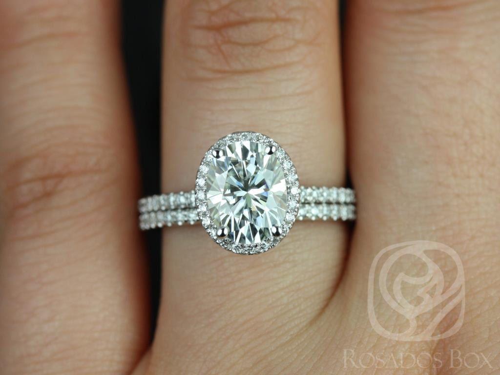 https://www.loveandpromisejewelers.com/media/catalog/product/cache/1b8ff75e92e9e3eb7d814fc024f6d8df/f/e/federella_medio_size_14kt_white_gold_oval_fb_moissanite_and_diamond_halo_classic_wedding_set_1wm_.jpg