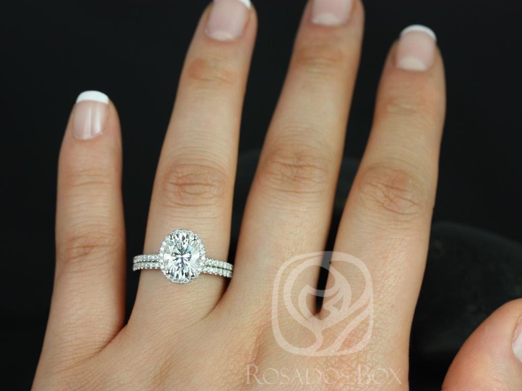 https://www.loveandpromisejewelers.com/media/catalog/product/cache/1b8ff75e92e9e3eb7d814fc024f6d8df/f/e/federella_medio_size_14kt_white_gold_oval_fb_moissanite_and_diamond_halo_classic_wedding_set_2wm_.jpg
