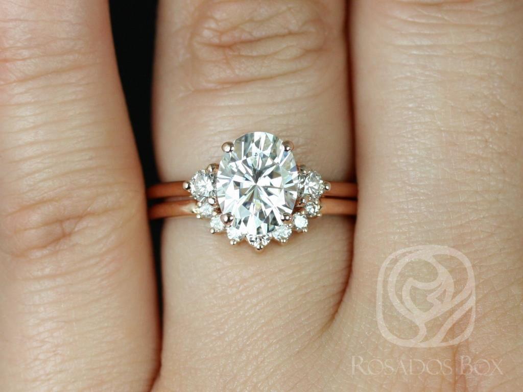 https://www.loveandpromisejewelers.com/media/catalog/product/cache/1b8ff75e92e9e3eb7d814fc024f6d8df/g/l/gloria_9x7mm_rayna_14kt_rose_gold_oval_f1-_moissanite_and_diamonds_3_stone_sunburst_wedding_set_2_.jpg