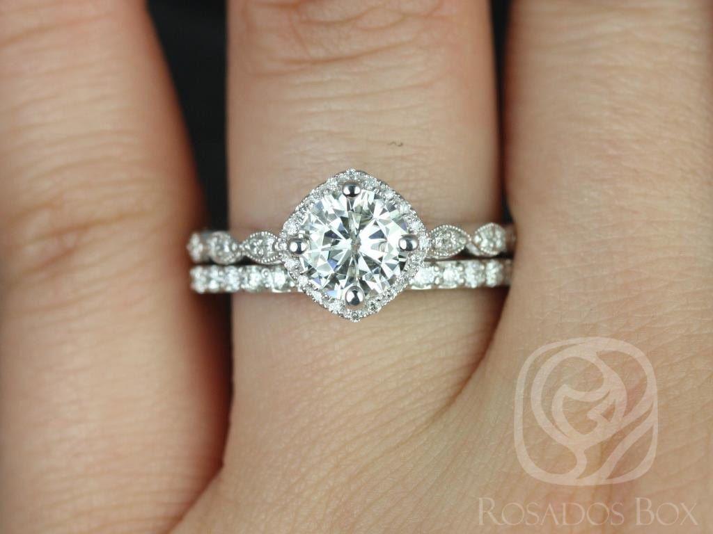https://www.loveandpromisejewelers.com/media/catalog/product/cache/1b8ff75e92e9e3eb7d814fc024f6d8df/k/a/katya_7mm_taylor_14kt_white_gold_round_fb_moissanite_and_diamond_halo_with_milgrain_engagement_ring_1wm_.jpg