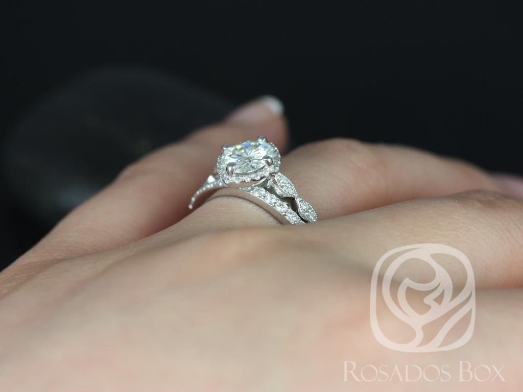 https://www.loveandpromisejewelers.com/media/catalog/product/cache/1b8ff75e92e9e3eb7d814fc024f6d8df/k/a/katya_7mm_taylor_14kt_white_gold_round_fb_moissanite_and_diamond_halo_with_milgrain_engagement_ring_3wm_.jpg