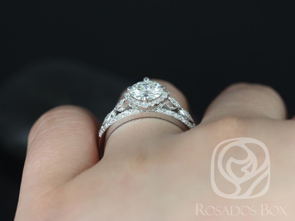 https://www.loveandpromisejewelers.com/media/catalog/product/cache/1b8ff75e92e9e3eb7d814fc024f6d8df/k/a/katya_7mm_taylor_14kt_white_gold_round_fb_moissanite_and_diamond_halo_with_milgrain_engagement_ring_4wm_.jpg