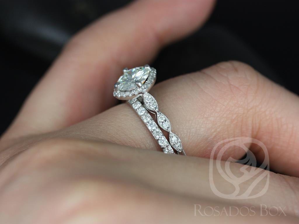 https://www.loveandpromisejewelers.com/media/catalog/product/cache/1b8ff75e92e9e3eb7d814fc024f6d8df/k/a/katya_7mm_taylor_14kt_white_gold_round_fb_moissanite_and_diamond_halo_with_milgrain_engagement_ring_5wm_.jpg