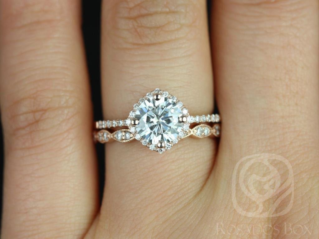 https://www.loveandpromisejewelers.com/media/catalog/product/cache/1b8ff75e92e9e3eb7d814fc024f6d8df/k/i/kitana_original_christie_14kt_rose_gold_fb_moissanite_and_diamonds_cushion_halo_wedding_set_4wm_.jpg