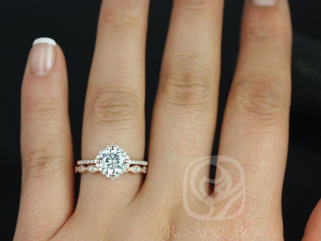 https://www.loveandpromisejewelers.com/media/catalog/product/cache/1b8ff75e92e9e3eb7d814fc024f6d8df/k/i/kitana_original_christie_14kt_rose_gold_fb_moissanite_and_diamonds_cushion_halo_wedding_set_5wm_.jpg