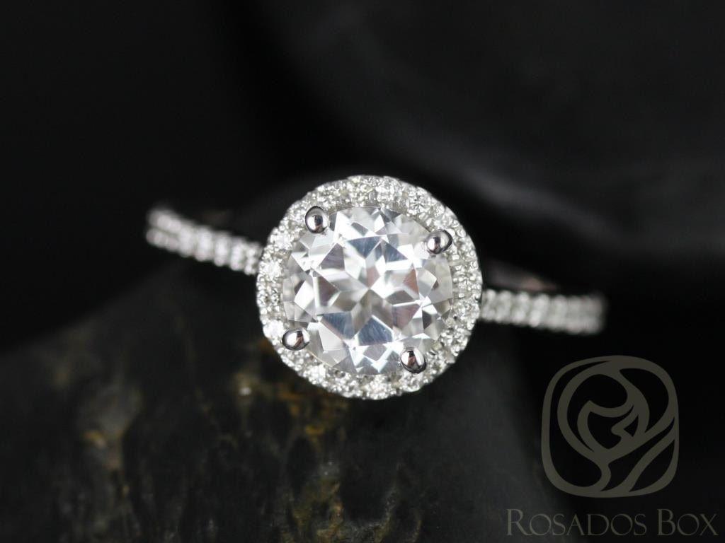 https://www.loveandpromisejewelers.com/media/catalog/product/cache/1b8ff75e92e9e3eb7d814fc024f6d8df/k/u/kubian_7mm_14kt_white_gold_round_white_topaz_and_diamonds_halo_engagement_ring1wm.jpg