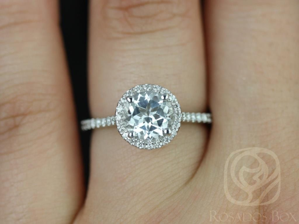 https://www.loveandpromisejewelers.com/media/catalog/product/cache/1b8ff75e92e9e3eb7d814fc024f6d8df/k/u/kubian_7mm_14kt_white_gold_round_white_topaz_and_diamonds_halo_engagement_ring3wm.jpg