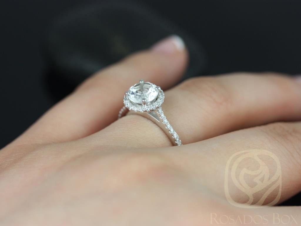 https://www.loveandpromisejewelers.com/media/catalog/product/cache/1b8ff75e92e9e3eb7d814fc024f6d8df/k/u/kubian_7mm_14kt_white_gold_round_white_topaz_and_diamonds_halo_engagement_ring56wm.jpg