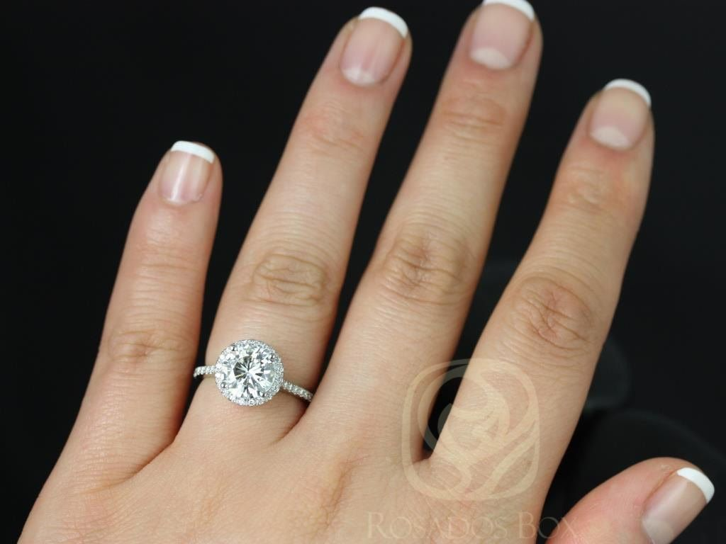 https://www.loveandpromisejewelers.com/media/catalog/product/cache/1b8ff75e92e9e3eb7d814fc024f6d8df/k/u/kubian_8mm14kt_white_gold_round_fb_moissanite_and_diamonds_halo_engagement_ring4wm_1_1.jpg