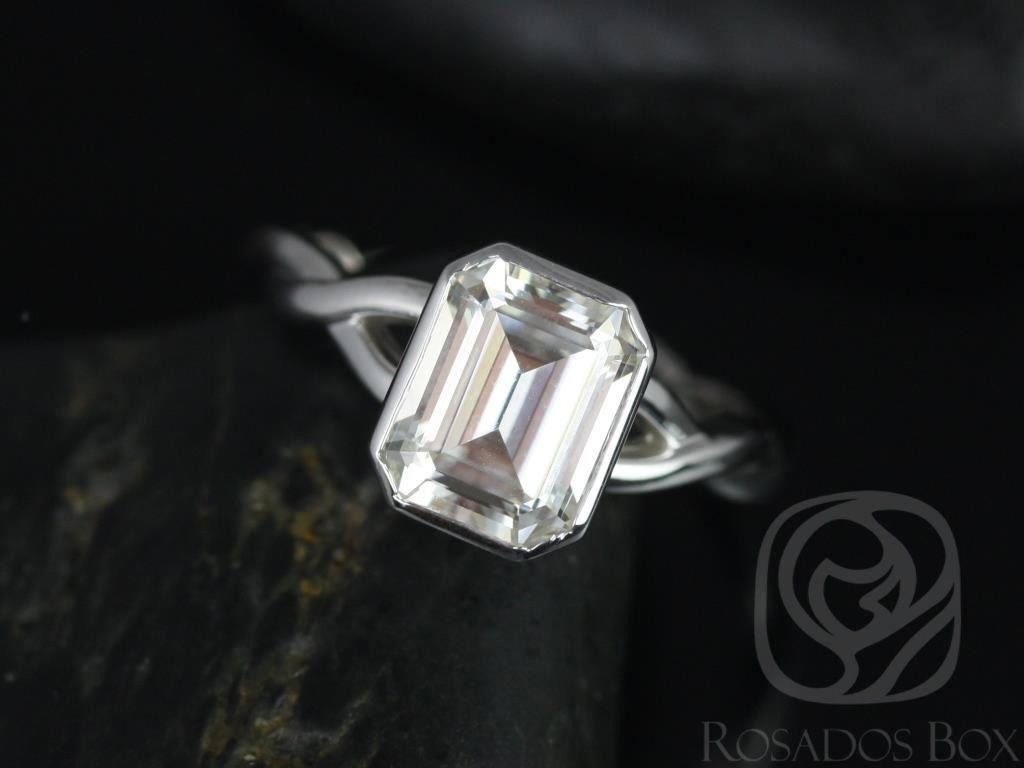 https://www.loveandpromisejewelers.com/media/catalog/product/cache/1b8ff75e92e9e3eb7d814fc024f6d8df/l/e/leslie_9x7mm_14kt_white_gold_emerald_fb_moissanite_bezel_twist_engagement_ring_2wm_.jpg