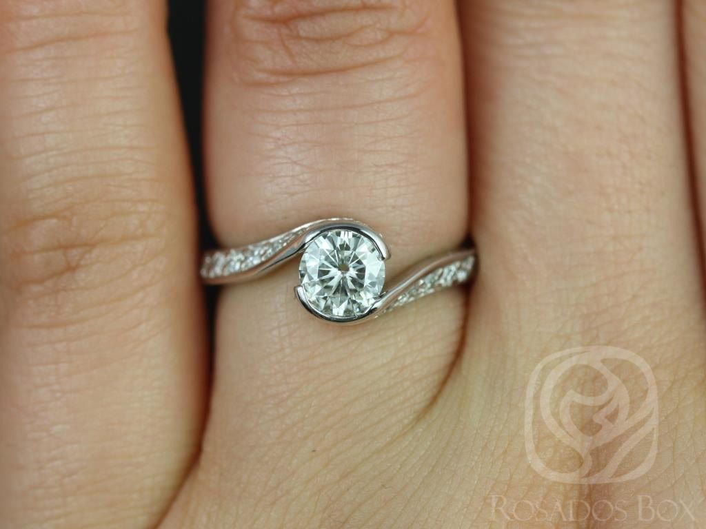 https://www.loveandpromisejewelers.com/media/catalog/product/cache/1b8ff75e92e9e3eb7d814fc024f6d8df/o/d/odala_5.5mm_14kt_white_gold_round_fb_moissanite_and_diamonds_twisted_engagement_ring_other_metals_and_stone_options_available_3wm.jpg