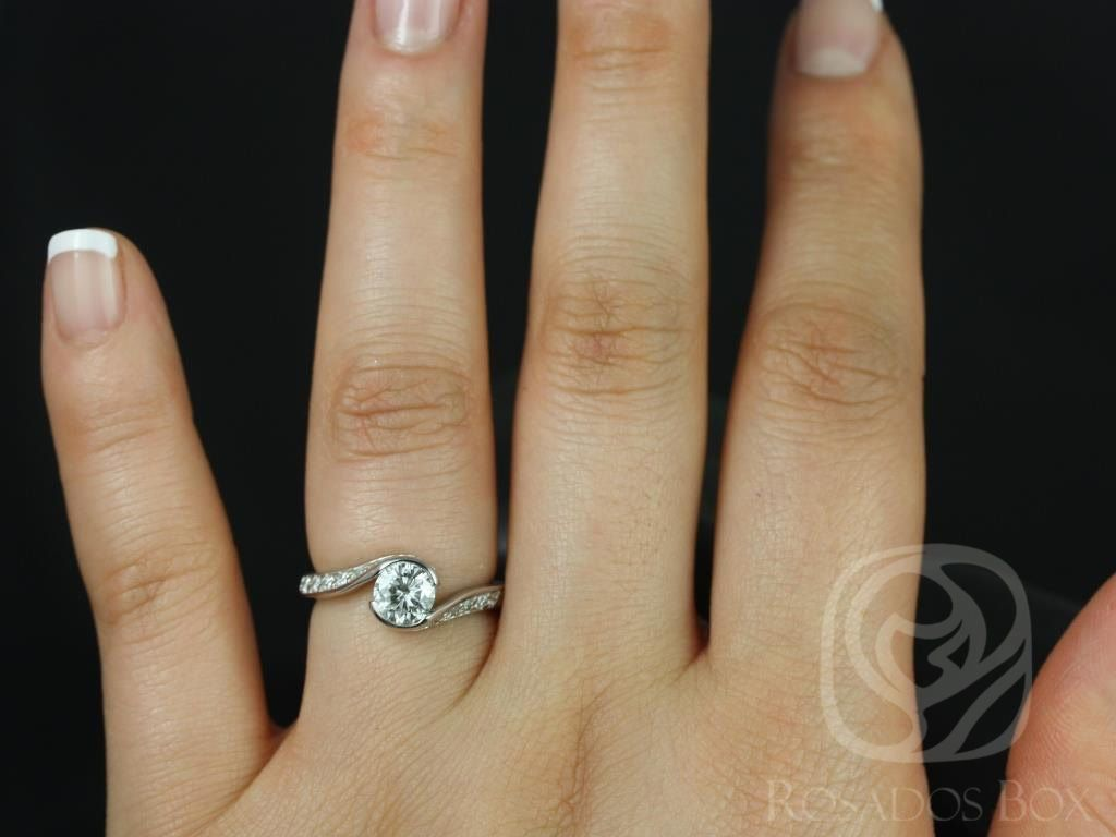 https://www.loveandpromisejewelers.com/media/catalog/product/cache/1b8ff75e92e9e3eb7d814fc024f6d8df/o/d/odala_5.5mm_14kt_white_gold_round_fb_moissanite_and_diamonds_twisted_engagement_ring_other_metals_and_stone_options_available_4wm.jpg