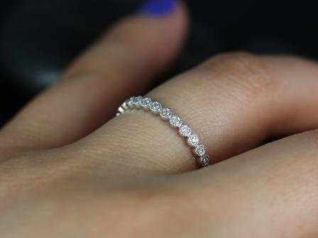 https://www.loveandpromisejewelers.com/media/catalog/product/cache/1b8ff75e92e9e3eb7d814fc024f6d8df/p/e/petite_bubbles_with_milgrain_almost_eternity_band_1_.jpg