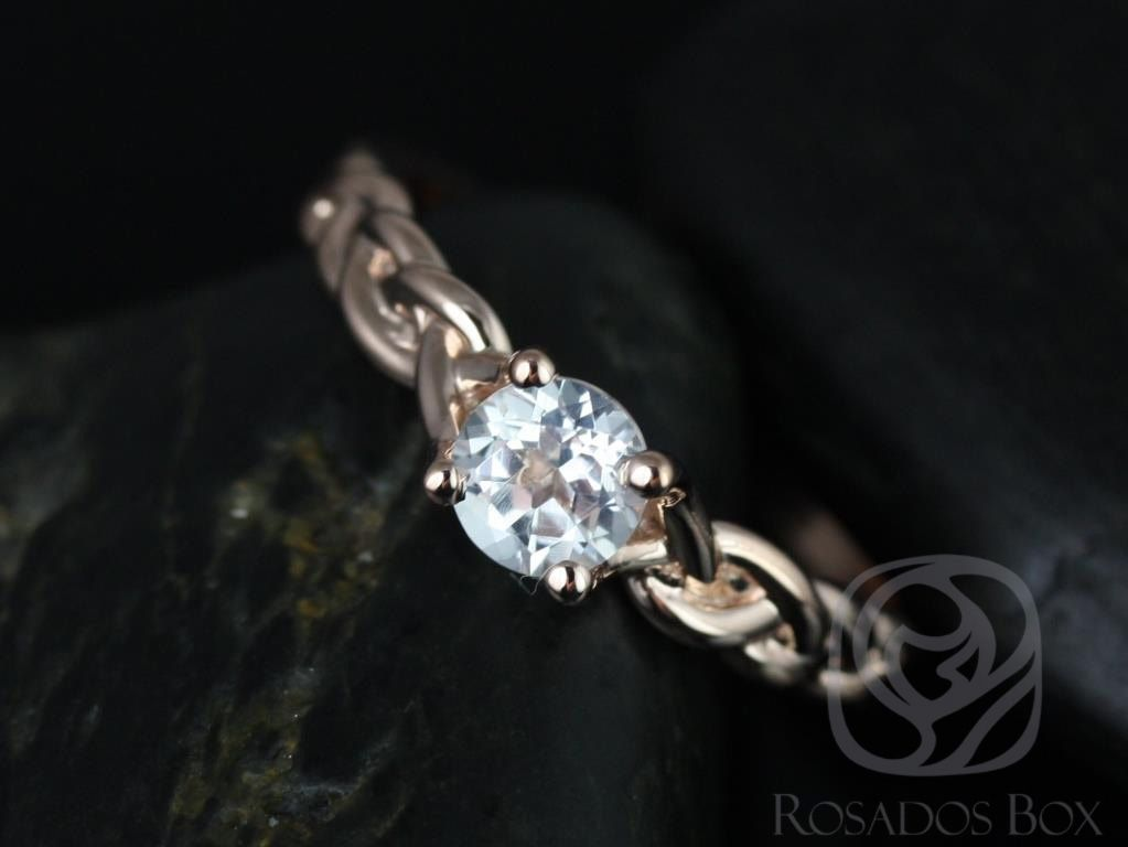 https://www.loveandpromisejewelers.com/media/catalog/product/cache/1b8ff75e92e9e3eb7d814fc024f6d8df/p/r/prudence_5mm_14kt_rose_gold_round_white_topaz_braided_engagement_ring_other_metals_and_stone_options_available_1wm.jpg