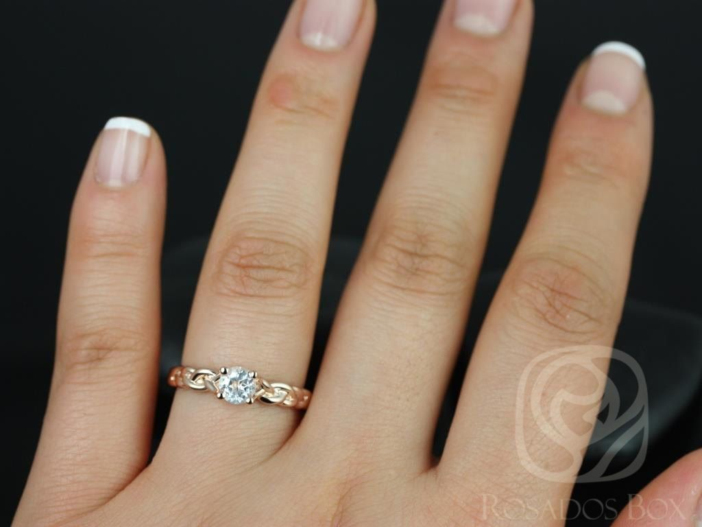 https://www.loveandpromisejewelers.com/media/catalog/product/cache/1b8ff75e92e9e3eb7d814fc024f6d8df/p/r/prudence_5mm_14kt_rose_gold_round_white_topaz_braided_engagement_ring_other_metals_and_stone_options_available_4wm.jpg