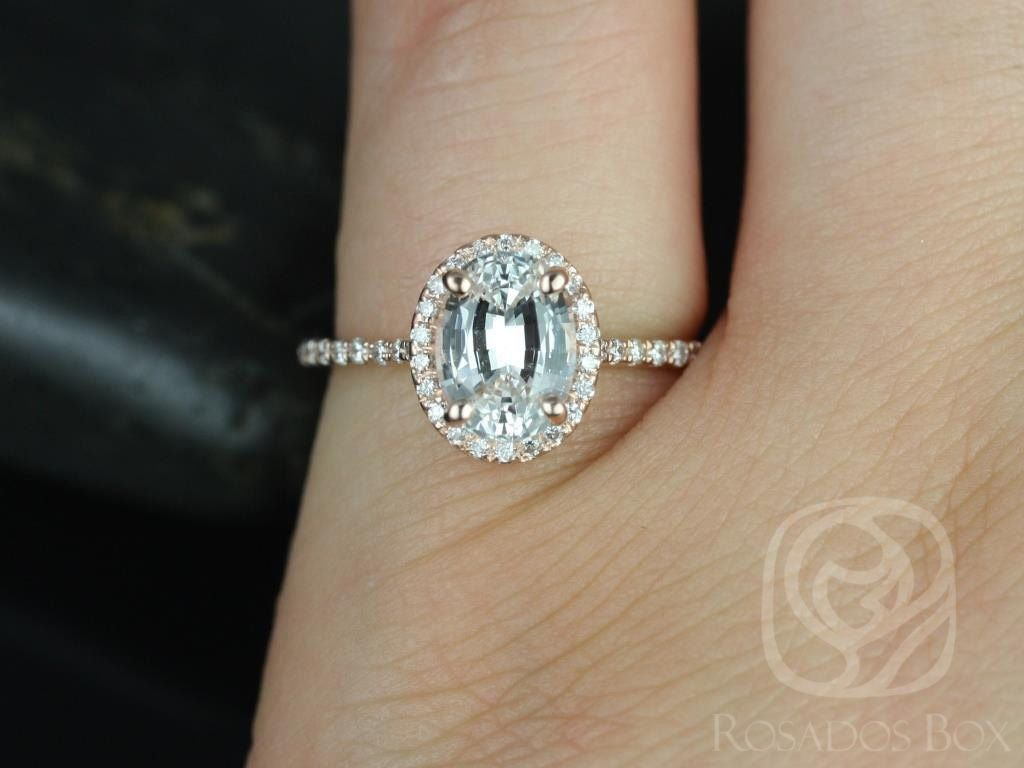 https://www.loveandpromisejewelers.com/media/catalog/product/cache/1b8ff75e92e9e3eb7d814fc024f6d8df/r/e/rebecca_8x6mm_14kt_rose_gold_oval_white_sapphire_and_diamonds_halo_engagement_ring_other_metals_and_stone_options_available_3wm.jpg