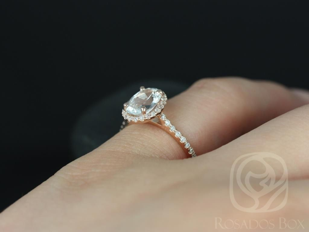 https://www.loveandpromisejewelers.com/media/catalog/product/cache/1b8ff75e92e9e3eb7d814fc024f6d8df/r/e/rebecca_8x6mm_14kt_rose_gold_oval_white_sapphire_and_diamonds_halo_engagement_ring_other_metals_and_stone_options_available_5wm.jpg