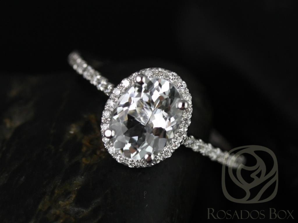 https://www.loveandpromisejewelers.com/media/catalog/product/cache/1b8ff75e92e9e3eb7d814fc024f6d8df/r/e/rebecca_8x6mm_14kt_white_gold_oval_white_sapphire_and_diamonds_halo_engagement_ring_other_metals_and_stone_options_available_1wm.jpg