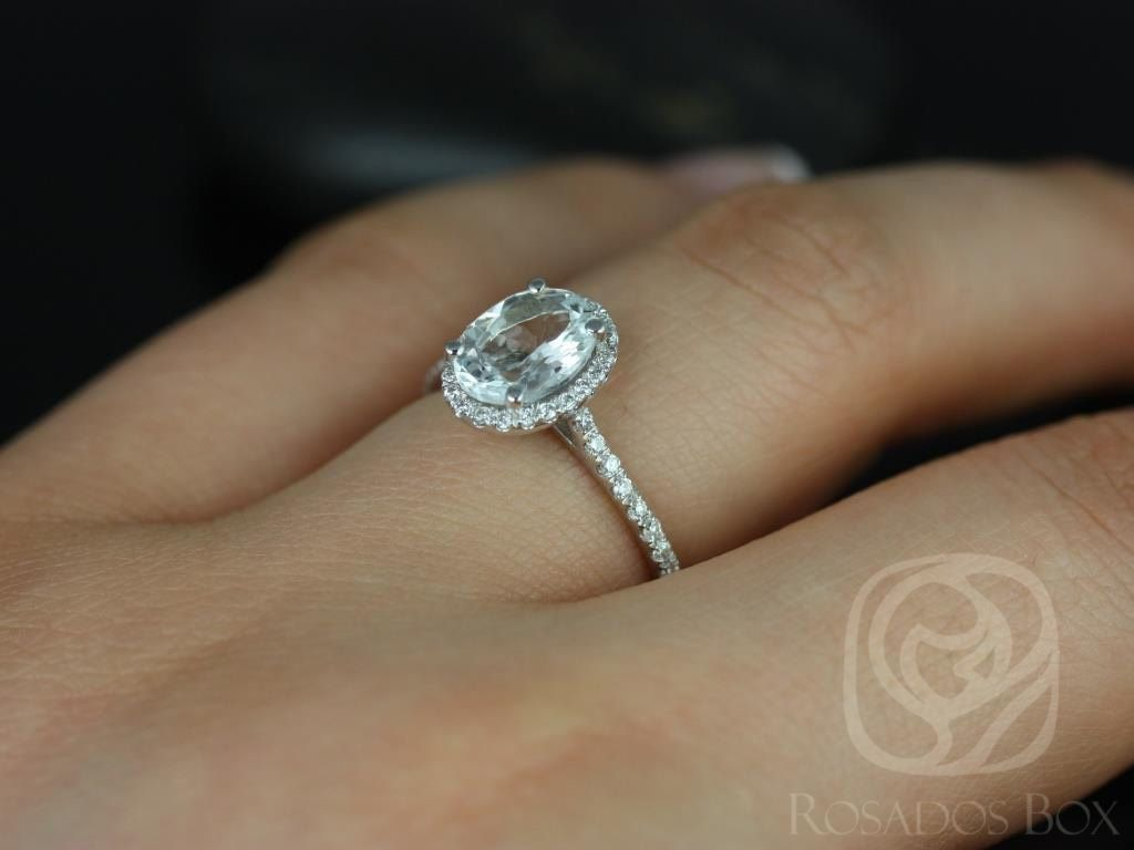 https://www.loveandpromisejewelers.com/media/catalog/product/cache/1b8ff75e92e9e3eb7d814fc024f6d8df/r/e/rebecca_8x6mm_14kt_white_gold_oval_white_sapphire_and_diamonds_halo_engagement_ring_other_metals_and_stone_options_available_4wm.jpg