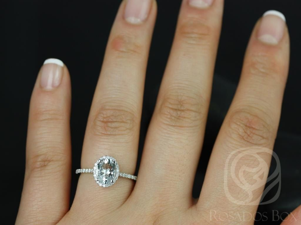 https://www.loveandpromisejewelers.com/media/catalog/product/cache/1b8ff75e92e9e3eb7d814fc024f6d8df/r/e/rebecca_8x6mm_14kt_white_gold_oval_white_sapphire_and_diamonds_halo_engagement_ring_other_metals_and_stone_options_available_5wm.jpg
