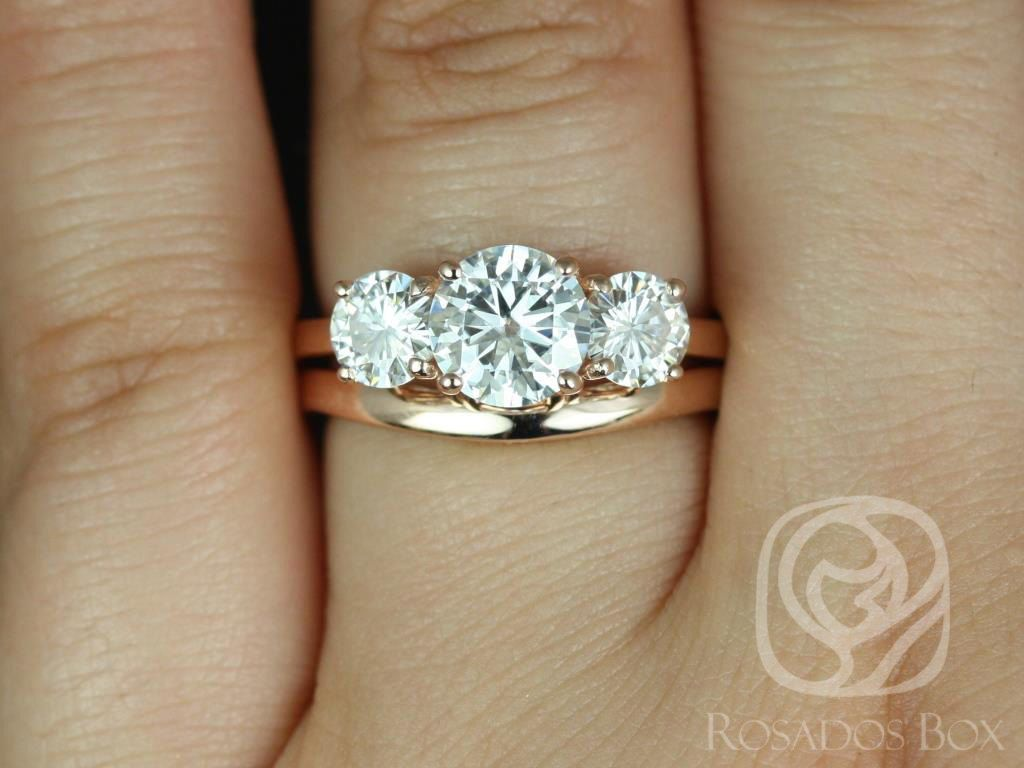 https://www.loveandpromisejewelers.com/media/catalog/product/cache/1b8ff75e92e9e3eb7d814fc024f6d8df/r/o/robyn_7mm_14kt_rose_gold_round_fb_moissanite_3_stone_wedding_set_1.jpg