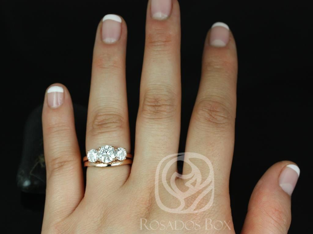 https://www.loveandpromisejewelers.com/media/catalog/product/cache/1b8ff75e92e9e3eb7d814fc024f6d8df/r/o/robyn_7mm_14kt_rose_gold_round_fb_moissanite_3_stone_wedding_set_2.jpg