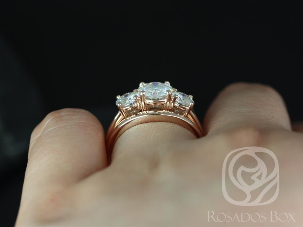 https://www.loveandpromisejewelers.com/media/catalog/product/cache/1b8ff75e92e9e3eb7d814fc024f6d8df/r/o/robyn_7mm_14kt_rose_gold_round_fb_moissanite_3_stone_wedding_set_4.jpg