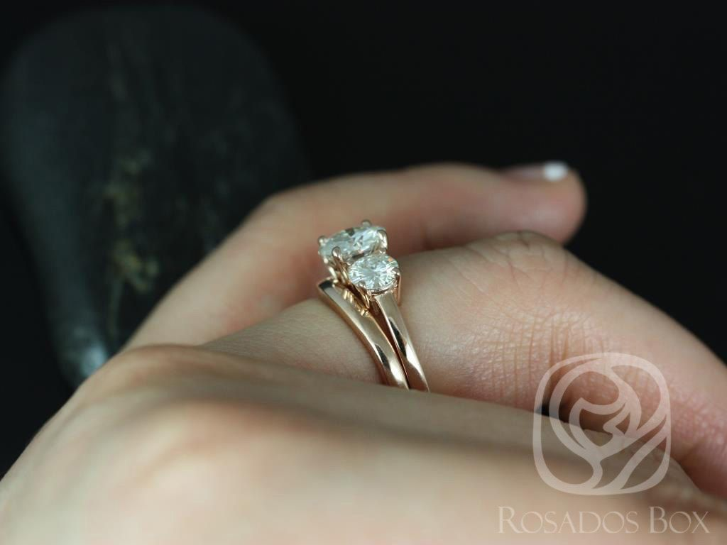 https://www.loveandpromisejewelers.com/media/catalog/product/cache/1b8ff75e92e9e3eb7d814fc024f6d8df/r/o/robyn_7mm_14kt_rose_gold_round_fb_moissanite_3_stone_wedding_set_5.jpg