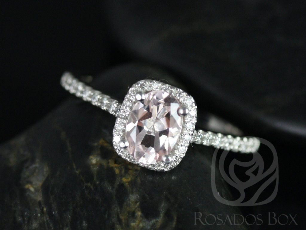 https://www.loveandpromisejewelers.com/media/catalog/product/cache/1b8ff75e92e9e3eb7d814fc024f6d8df/r/o/romani_7x5mm_platinum_morganite_and_diamonds_cushion_halo_engagement_ring_1_wm.jpg