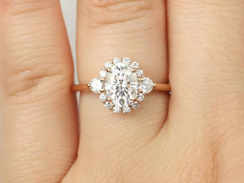https://www.loveandpromisejewelers.com/media/catalog/product/cache/1b8ff75e92e9e3eb7d814fc024f6d8df/r/o/rosados_box_britney_8x6mm_14kt_rose_gold_oval_forever_one_moissanite_and_diamonds_halo_engagement_ring_1_.jpg