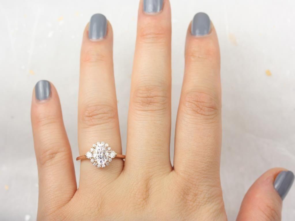 https://www.loveandpromisejewelers.com/media/catalog/product/cache/1b8ff75e92e9e3eb7d814fc024f6d8df/r/o/rosados_box_britney_8x6mm_14kt_rose_gold_oval_forever_one_moissanite_and_diamonds_halo_engagement_ring_2_.jpg
