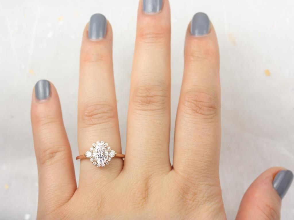 https://www.loveandpromisejewelers.com/media/catalog/product/cache/1b8ff75e92e9e3eb7d814fc024f6d8df/r/o/rosados_box_britney_8x6mm_14kt_rose_gold_oval_forever_one_moissanite_and_diamonds_halo_engagement_ring_2__1.jpg